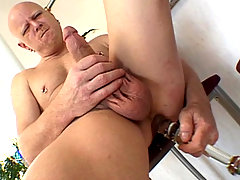 DILF stud in huge dildos anal toying fun in the kitchen