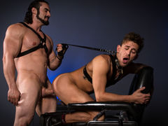 With a slender cane in his grip, Jaxton Wheeler menaces his sub, Alexander Gustavo. Pulling back the lean rod, Jaxton lets it slap across Alexander's bare, unprotected ass and legs. Jaxton penetrates Alexander's tight hole using a cane with a sphere on th
